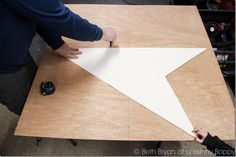 Make a big star .. easy way to draw it out. star-22http://unskinnyboppy.com/2013/12/diy-giant-wooden-star-christmas-mantel/