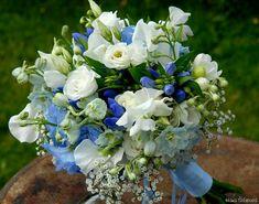 Lovely Hand Tied Wedding Bouquet Featuring: White Lisianthus, White Sweet Pea,  White Freesia, White Gypsophila (Baby's Breath), Blue Agapanthus, Blue Delphinium ••••
