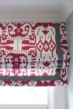 """Custom Roman Shade by Lynn Chalk in Quadrille China Seas Island Ikat in Magenta with Samuel and Sons 977-44932  1.5"""" Grosgrain Ribbon in Steel, $550.00 (http://store.lynnchalk.com/quadrille-roman-shades-in-island-ikat-in-magenta-with-samuel-and-sons-steel-977-44932-1-5-grosgrain-ribbon/)"""