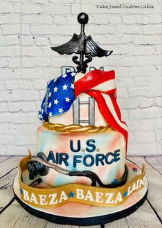 This cake celebrates our hard working heros in thr air force who have just been promoted. This cake is vanilla cake with lemon buttercream. The flag and other items are all fondant and hand-painted.