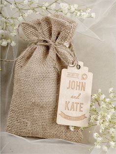 Burlap drawstring pouch with a wooden tag #wedding #weddingfavors #rustic #chic #burlap