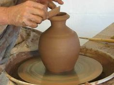 Paddling a Thrown Bottle and Cup - (Good collaring tip: use finger INSIDE to compress clay as you collar)
