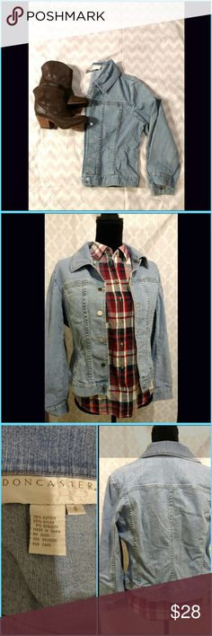 Jean Jacket Super cute, gently pre-owned jean jacket. Good, pre-owned condition. (Clean and I didn't notice and marks or wear.) Two, narrow, vertical pockets on the front. Sits at the waist (shorter length). Cute with blue jeans and belt, Jean Skirt or summer dress! Doncaster Jackets & Coats Jean Jackets