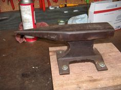 Railroad Track Anvil by snapmom -- Homemade anvil adapted from a section of railroad track and mounted on a wooden slab. http://www.homemadetools.net/homemade-railroad-track-anvil-3