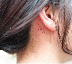 Delicate floral tattoo behind ear