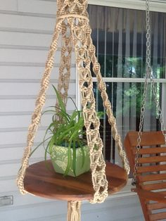 Macrame hanging table in jute colored 6 mm Polyolefin cord. Wooden insert is not included. It measures about 61 (155 cm) from the top ring to the bottom of the tassel with the tray shown. Top of the ring to bottom of 18 (47 cm) diameter wooden table is 45 (114 cm). Tassel measures between 10-15 (26-38 cm) and may differ slightly in look from photo. Sinnets leading down are about 30 (75 cm) long. It is shown with a 18 wooden tray and a 19 glass tray. Measurements are approximate and may vary…