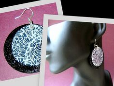 https://flic.kr/p/3Y5dNv | polymer clay and stirling silver Disc earings | double layer movable polymer clay earings. Bottom disc is glossy black embossed and top layer is translucent and white lace cane over black.