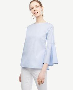 """In crisp cotton poplin, our fluted sleeve shirt breezes through the season with just the right swing. Boatneck. 3/4 fluted sleeves. Button back placket. Back flounce hem. 25"""" long."""