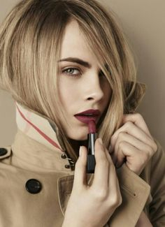 Cara Delevingne working the perfect dark red lipstick