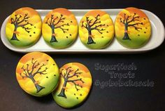Wind-blown leaves, bare tree decorated cookie