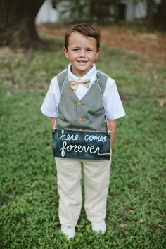 adorable #ringbearer | DIY Wedding at Mercury Hall from Tessa J Photography  Read more - http://www.stylemepretty.com/texas-weddings/2013/11/01/diy-wedding-at-mercury-hall-from-tessa-j-photography/