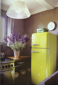 yellow vintage fridge/purple & white flowers