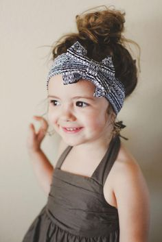 cute kid. top knot.