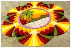 Rangoli Design with flowers and colored rice