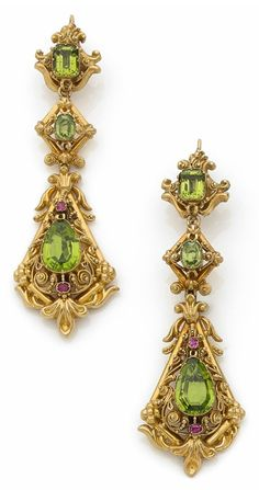 A pair of antique gold, peridot and pink sapphire earrings, circa 1840. Richly decorated with foliate motifs, set with cushion, oval and pear-shaped peridots and small pink sapphires. #antique #earrings