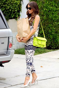 Kate Beckinsale The actress grounded Proenza Schouler's $3,150 python chartreuse carryall by wearing it with basic colors.