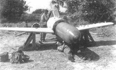 """The MXY-7 Navy Suicide Attacker Ohka was a manned flying bomb that was usually carried underneath a Mitsubishi G4M2e """"Betty"""" Model 24J bomber to within range of its target; on release, the pilot would first glide towards the target and when close enough he would fire the Ohka's three solid-fuel rockets, one at a time or in unison,[4] and fly the missile towards the ship that he intended to destroy."""