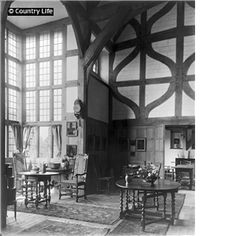 """Deanery Garden, """"The hall, with its huge oriel window, seen from the screens passage. The  door in the panelling to the right leads to the dining room."""" 1"""