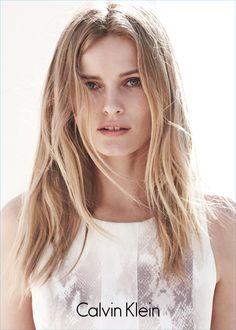 Model Edita Vilkeviciute in the animal print neoprene dress from Spring 2015 Calvin Klein white label.