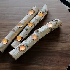 Simple tutorial for making beautiful, winter fire light from birch logs and tea candles.