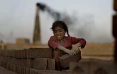 Islamabad, Pakistan: Naginah Sadiq, five, lays bricks at the brick factory where she and her family work. Naginah earns 250 rupees per day according to her father. Photograph: Muhammed Muheisen/A Child Of The Universe, Photographs Of People, Save The Children, Photos, Pictures, Make Me Smile, Street Photography, Told You So, Around The Worlds