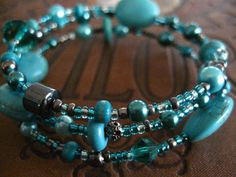 Turquoise and Hematite Wrapped Memory Wire Bracelet   This 3 loop Memory Wire Bracelet creates a multi-strand layered look. The Bracelet is made