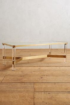 "Oscarine Lucite Coffee Table, Rectangle #anthropologie $898 16.5'H, 47""W, 24"" D 14.5 under table clearance"
