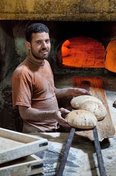 Egyptian baker at his best making pita bread.