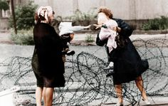 Bidding farewell over the barbed wire, Berlin, 1961.