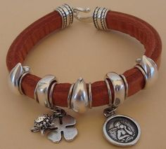 Genuine leather charming bracelet via Yucamar. Click on the image to see more!