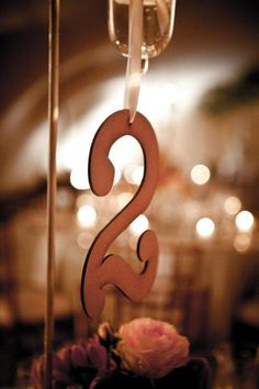 Very elegant and classic hanging table numbers for a beautiful wedding table. #Elsje Designs #weddings #tablenumbers