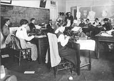 School of Journalism, women and men students in typing class and Professor Enoch Grehan, standing - date unknown