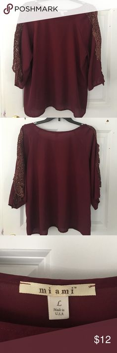 Miami maroon shirt PRICE FIRM Lightly worn three quarter sleeve maroon shirt, size large. Gold and maroon details on sleeves. PRICE IS FIRM ON THIS ITEM Miami Tops Blouses