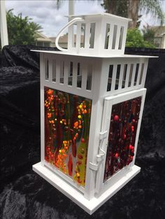 Work by Annie Dotzauer.  Lanterns with fused glass.  I call this rainbow bubbles.