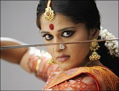 Lovely nose pin and jimkis-Actress Anushka Shetty in stills from Arundhati