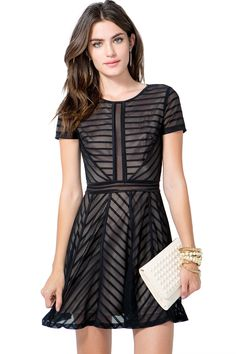 An alluring nighttime-ready flare dress, featuring a striped lacey overlay and full contrast lining. Round neck. Short sleeves. Slit back with a button loop and concealed zip closure. Defined waist. Finished short hem. $32.50