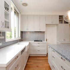 Kitchen. Pressed metal splashback, contrasting benchtops, maximum storage, handles, colours, timber floor. Love it all!