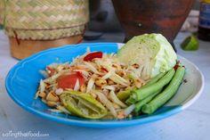 In this Thai green papaya salad recipe (ส้มตำ), you'll learn to make Thai street food style green papaya salad. It's easy to make and tastes delicious!