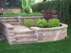 Brick steps - love it! If i have to terrace, this would be amazing up to a small patio-stone plateau with a small table and chairs