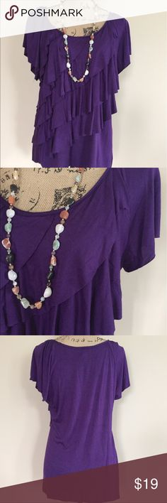 "Violet tiered ruffle top Pretty violet top with tiers of raw edge feminine ruffles down the front. Short sleeves, scoop neck, plain back. Size L. Excellent condition. 96% polyester 4% spandex. Made in USA. Machine wash. Bust measures 21"", length 27"". AGB Tops Blouses"