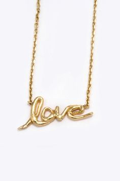 "Gold ""love"" necklace by Carolyn"