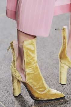 Velvet yellow ankle boots.
