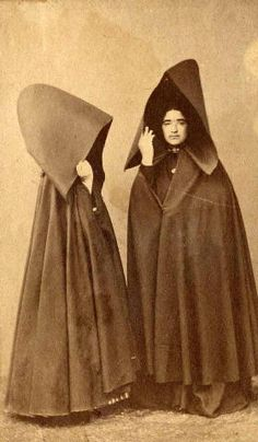 [Portugal/Azores, early 20th century] capote e capelo - Two women, one facing side and front, wearing capotes: long cloaks and large hoods http://75.150.122.156/newbedphoto/default.asp?IDCFile=DETAILSL.IDC,SPECIFIC=180412,LISTIDC=PAGEL.IDC,DATABASE=61009029,