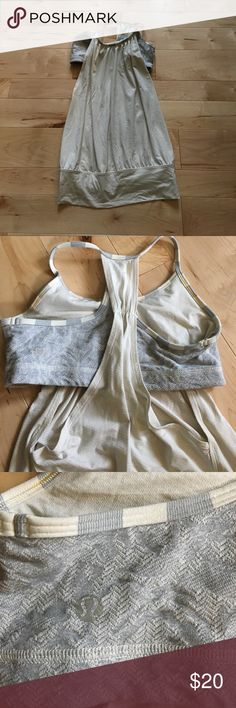 White and grey lululemon tank Loose white and grey tank with built in bra. This is the OG lululemon tank with cut out sides. lululemon athletica Tops Tank Tops