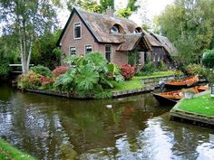"""If you ever wanted to live your own fairy-tale, you may want to consider moving to the village Giethoorn. Also known as """"the Venice of the Netherlands"""", this magical village is the kind most people could only dream of… Peaceful Places, Beautiful Places, Fairytale Cottage, Fairytale Book, Fairy Village, Travel With Kids, Wonders Of The World, Fairy Tales, Places To Visit"""