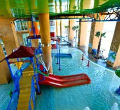 """The whole family will have fun at SPLASH!, where interactive water toys, water slides, a """"dive-in"""" movie theater, and arcade provide fun for all. Adults will appreciate the jetted tubs, poolside bar and grill, fitness center, and free high-speed Internet access."""