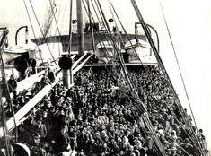 Immigrant ship arriving at Ellis Island.