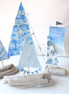 drift wood boats, painted sails