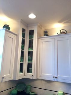 Custom white kitchen with inset cabinets, subway tile w/ glass bar liner and soapstone countertops, Caldera Design LLC