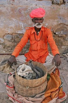 Snake charmer, Pushkar, Rajasthan, India by Ian Cowe, via Flickr